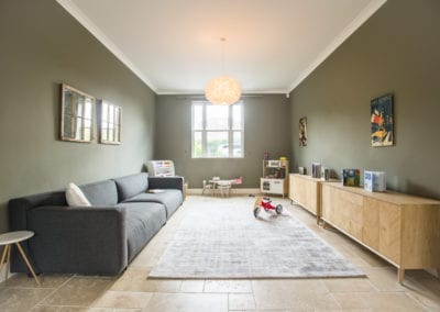 Family room sofa and storage. NW3 Interiors transformed our Beaconsfield Home. Click to view on the NW3 interior design portfolio.