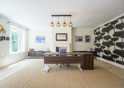 Home office with lighting and design elements on walls. NW3 Interiors transformed our Beaconsfield Home. Click to view on the NW3 interior design portfolio.