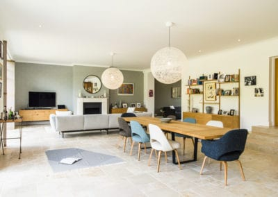 Open living space with dining table, TV and storage. NW3 Interiors transformed our Beaconsfield Home. Click to view on the NW3 interior design portfolio.