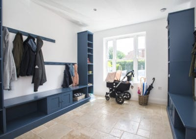 Mud room with storage options for coats, shoe etc in hallway. NW3 Interiors transformed our Beaconsfield Home. Click to view on the NW3 interior design portfolio.
