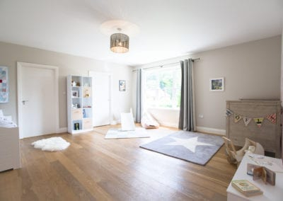 Kids bedroom with wooden floors. NW3 Interiors transformed our Beaconsfield Home. Click to view on the NW3 interior design portfolio.