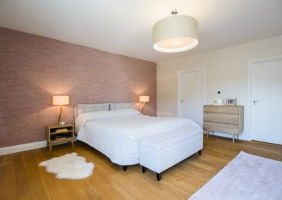Pink double bedroom. NW3 Interiors transformed our Beaconsfield Home. Click to view on the NW3 interior design portfolio.