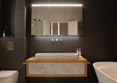 Mirror and Sink Unit Neutral. Bedroom in Belsize Park home. Interior Design Portfolio from NW3 Interiors. Click to view all our beautiful homes across Primrose Hill, Belsize Park and other areas in North London.