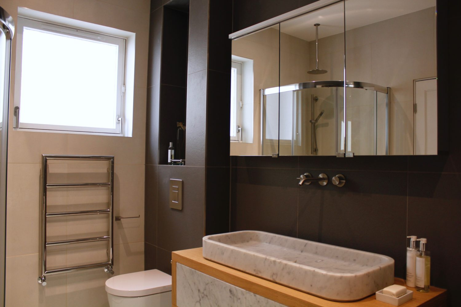 Bathroom Design for en suite. Bedroom in Belsize Park home. Interior Design Portfolio from NW3 Interiors. Click to view all our beautiful homes across Primrose Hill, Belsize Park and other areas in North London.