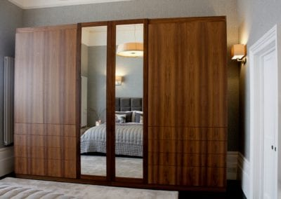 Bespoke Storage Unit for master bedroom. Bedroom in Belsize Park home. Interior Design Portfolio from NW3 Interiors. Click to view all our beautiful homes across Primrose Hill, Belsize Park and other areas in North London.