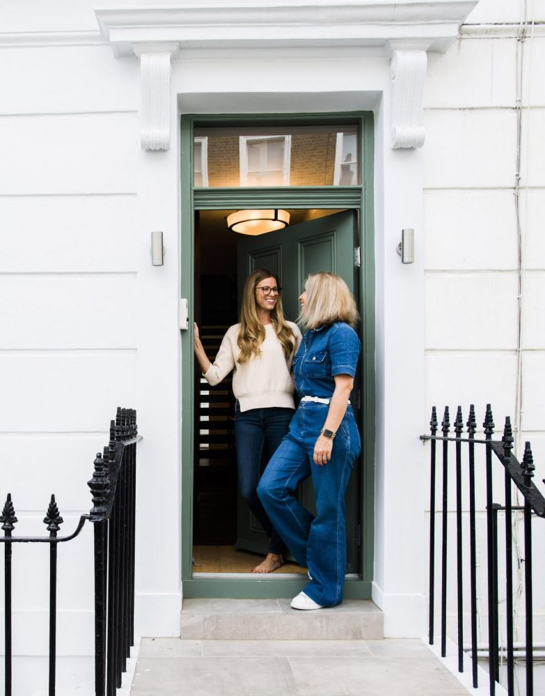 Carly and client in their doorway.
