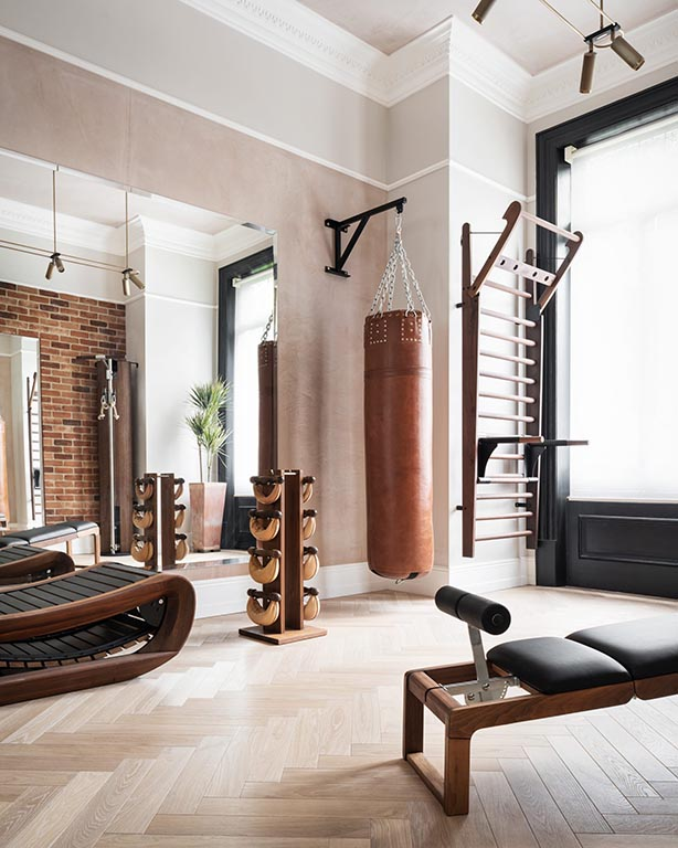 Home gym image with punch bag created by North London interior designers NW3 Interiors.