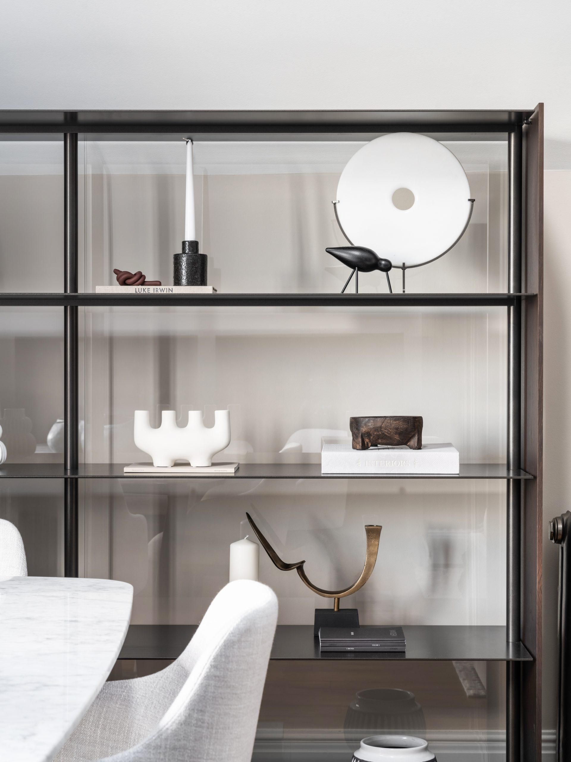 Storage shelves with ornaments and soft furnishings on, part of the NW3 Interior design services.